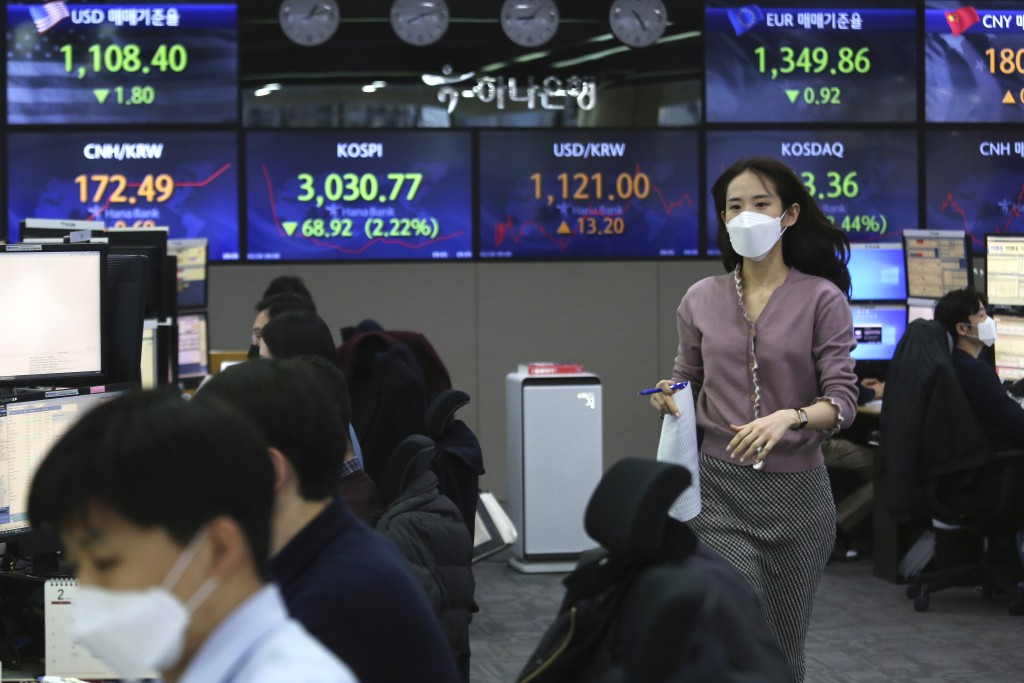A currency trader runs at the foreign exchange dealing room of the KEB Hana Bank headquarters in Seoul, South Korea, Friday, Feb. 26, 2021. Asian shar...