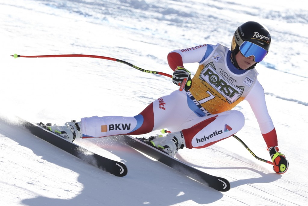 Switzerland's Lara Gut-Behrami speeds down the slope during an alpine ski, women's World Cup downhill, in Val di Fassa, Italy, Friday, Feb. 26, 2021. ...
