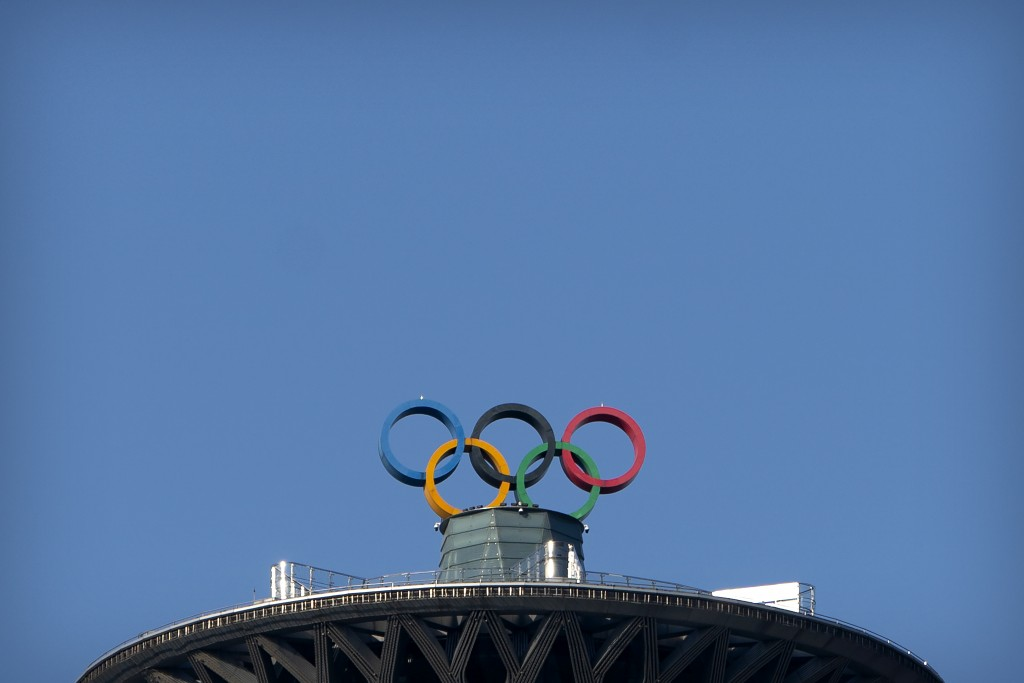 The Olympic rings are visible atop the Olympic Tower in Beijing, Tuesday, Feb. 2, 2021. A small core of international lawyers and activists are proddi...