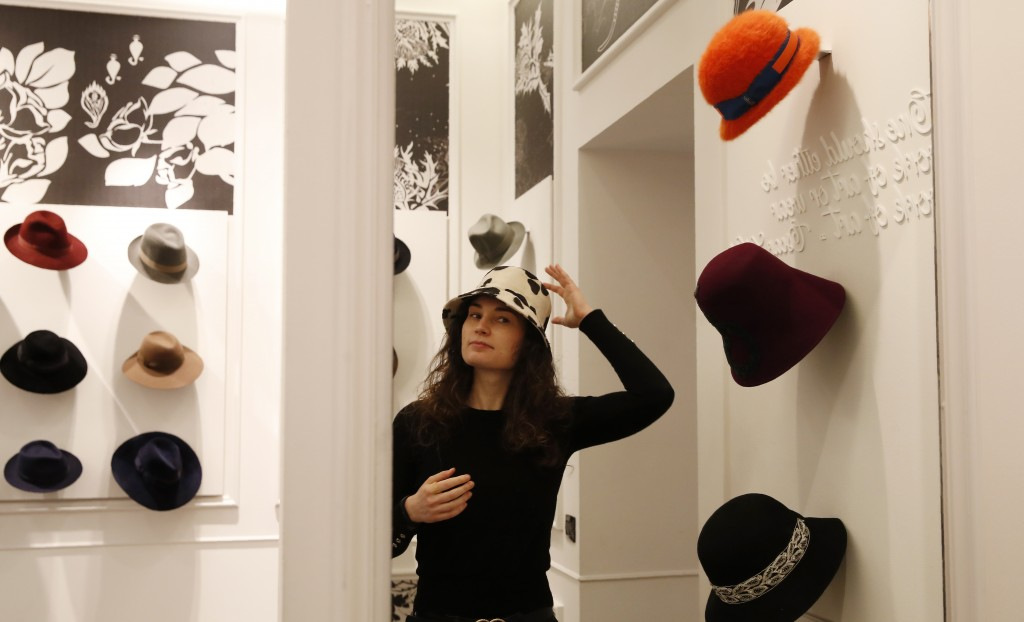 A girl wears a creation as part of the Borsalino women's Fall Winter 2021-22 collection, unveiled during the Fashion Week in Milan, Italy, Wednesday, ...