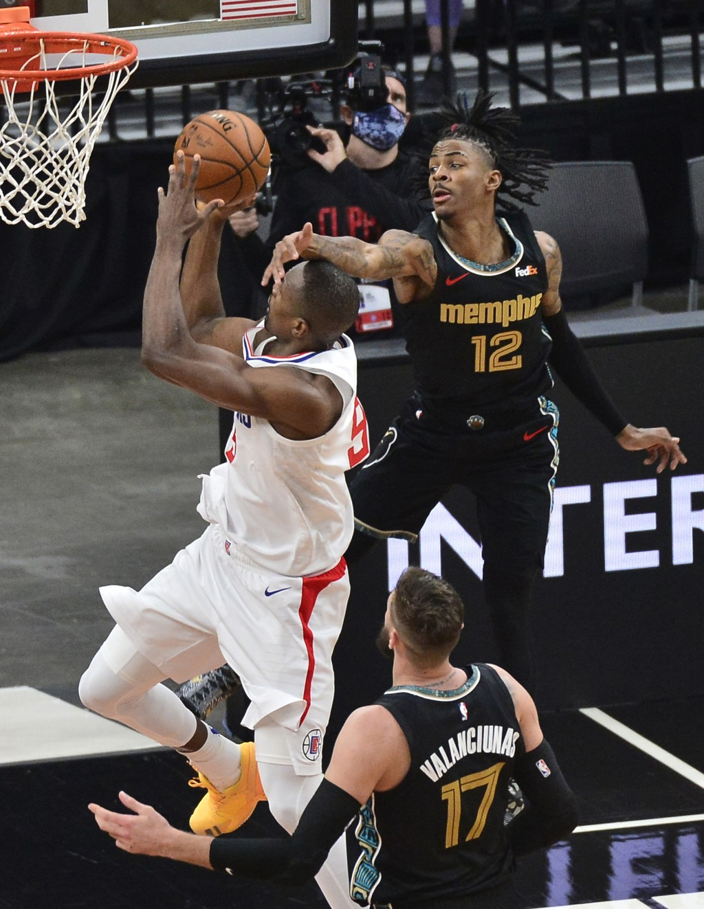 Los Angeles Clippers center Serge Ibaka (9) shoots as Memphis Grizzlies guard Ja Morant (12) gets a hand in front of his face during the first half of...