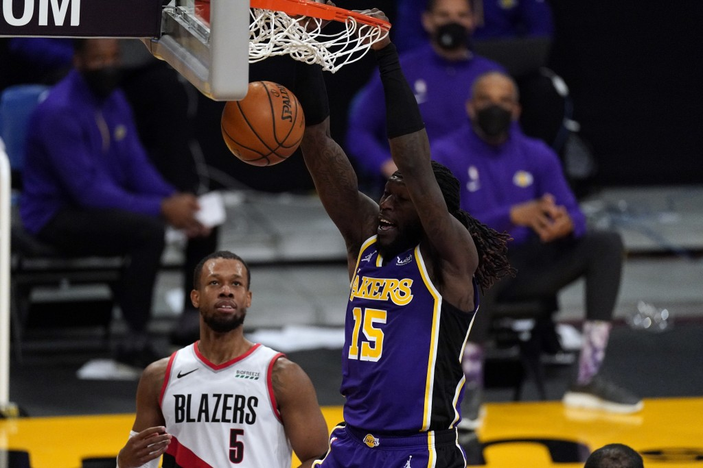 Los Angeles Lakers center Montrezl Harrell (15) dunks the ball during the first half of an NBA basketball game against the Portland Trail Blazers Frid...