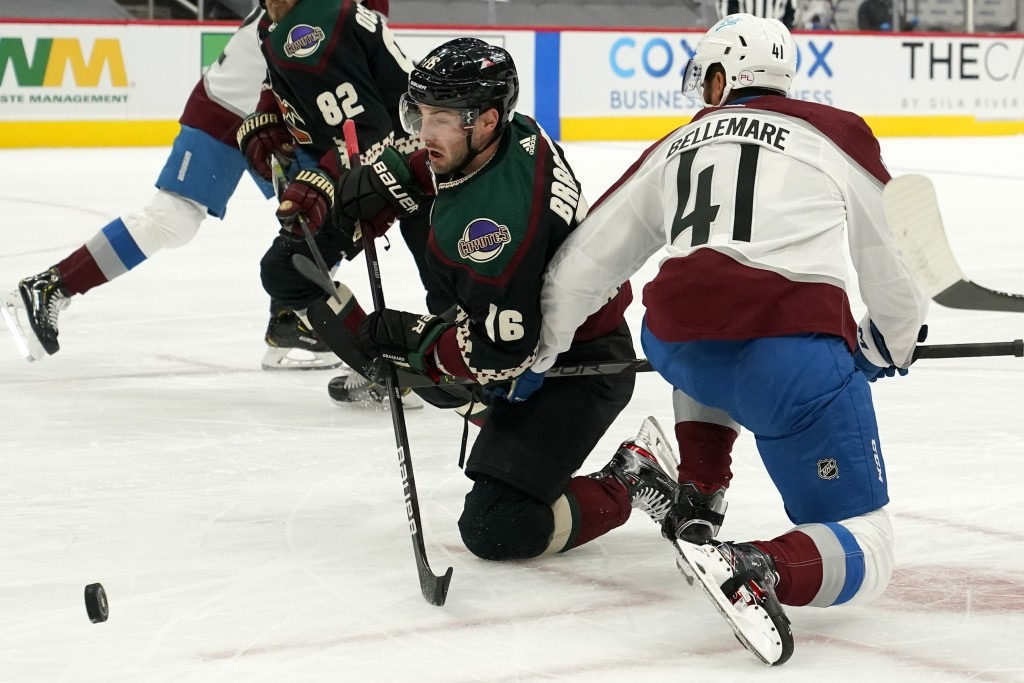 Arizona Coyotes center Derick Brassard (16) and Colorado Avalanche center Pierre-Edouard Bellemare (41) vie for the puck during the first period of an...