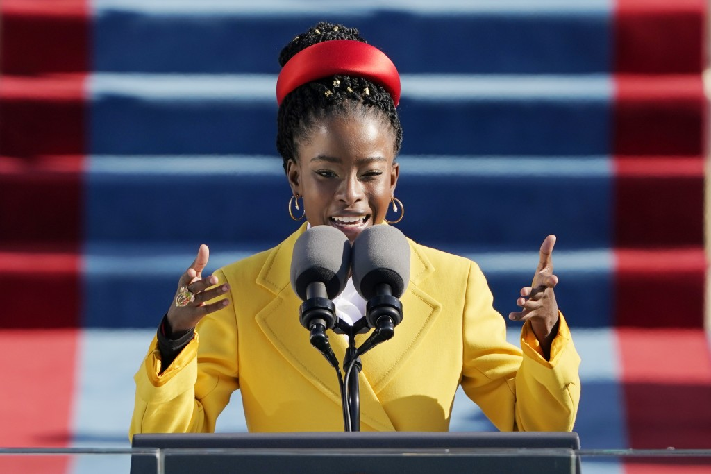 American poet Amanda Gorman reads a poem during the 59th Presidential Inauguration at the U.S. Capitol in Washington, Wednesday, Jan. 20, 2021. (AP Ph...
