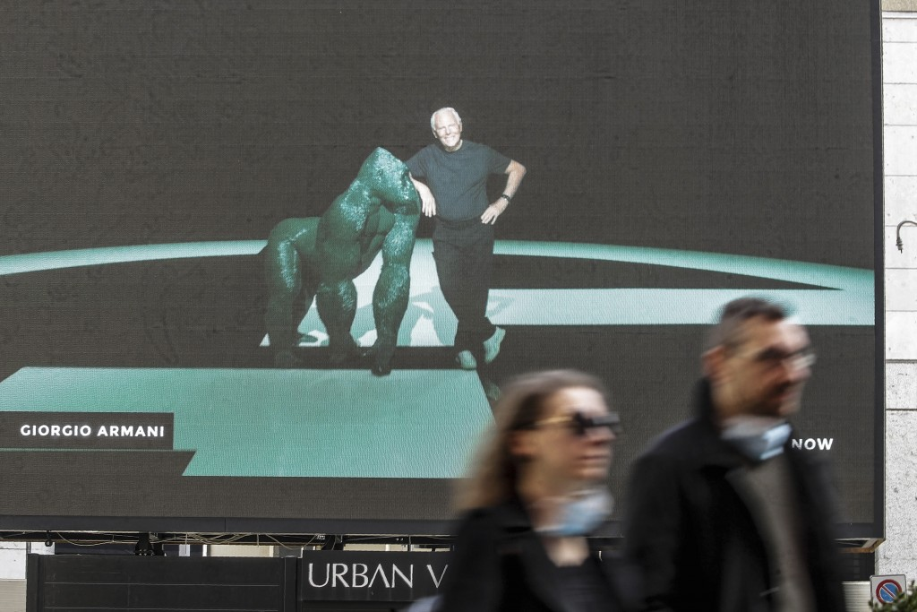 A giant screen streams a Giorgio Armani fashion live show presenting the women's Fall Winter 2021-22 collection, unveiled during the Fashion Week in M...