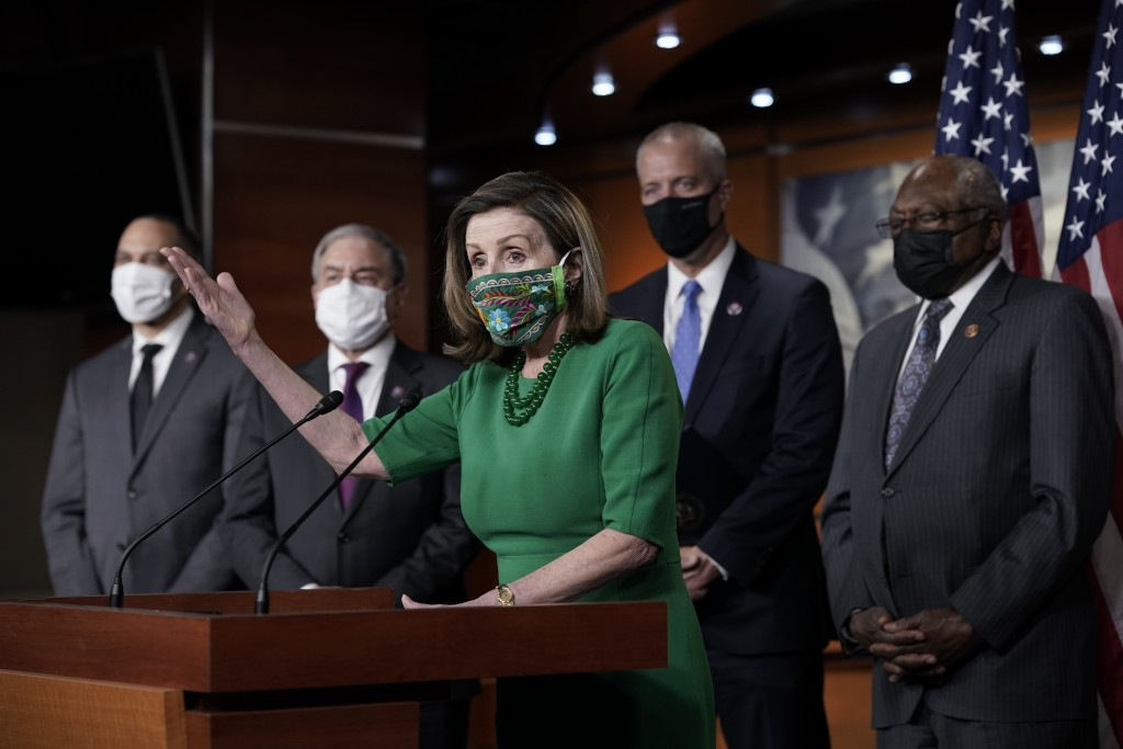 Speaker of the House Nancy Pelosi, D-Calif., meets with reporters before the House votes to pass a $1.9 trillion pandemic relief package, during a new...