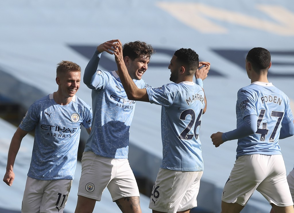 Manchester City's John Stones, second left, celebrates with teammates after scoring his side's second goal during the English Premier League soccer ma...