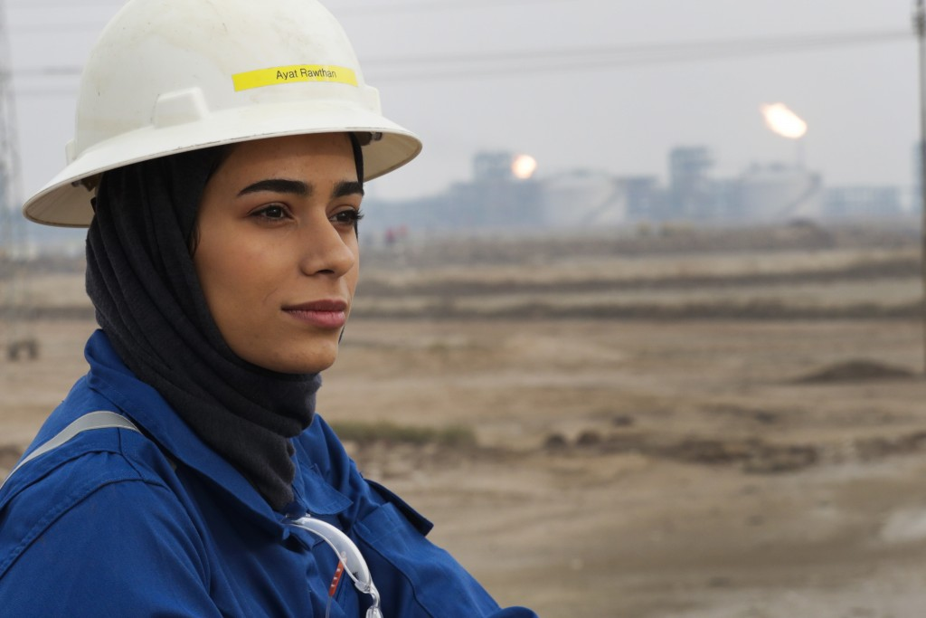 Ayat Rawthan, a petrochemical engineer, poses for a photo near an oil field outside Basra, Iraq, Tuesday, Feb. 5, 2021. Rawthan is among just a handfu...