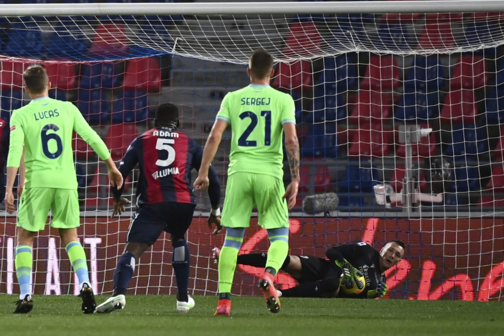 Bologna's goalkeeper Lukasz Skorupski saves a penalty from Lazio's Ciro Immobile during the Italian Serie A soccer match between Bologna and Lazio at ...