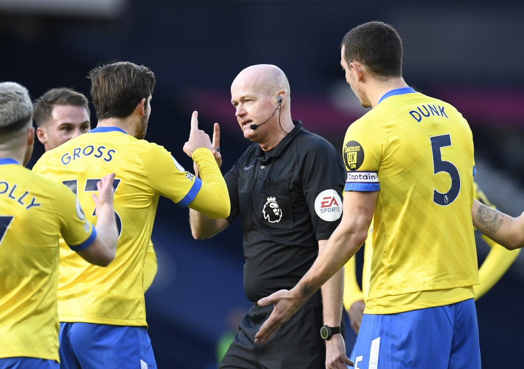 Brighton's Pascal Gross, left, argues with referee Lee Mason during the English Premier League soccer match between West Bromwich Albion and Brighton ...