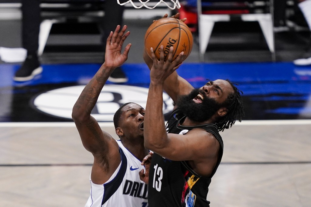 Brooklyn Nets guard James Harden (13) shoots against Dallas Mavericks forward Dorian Finney-Smith during during  the second half of an NBA basketball ...