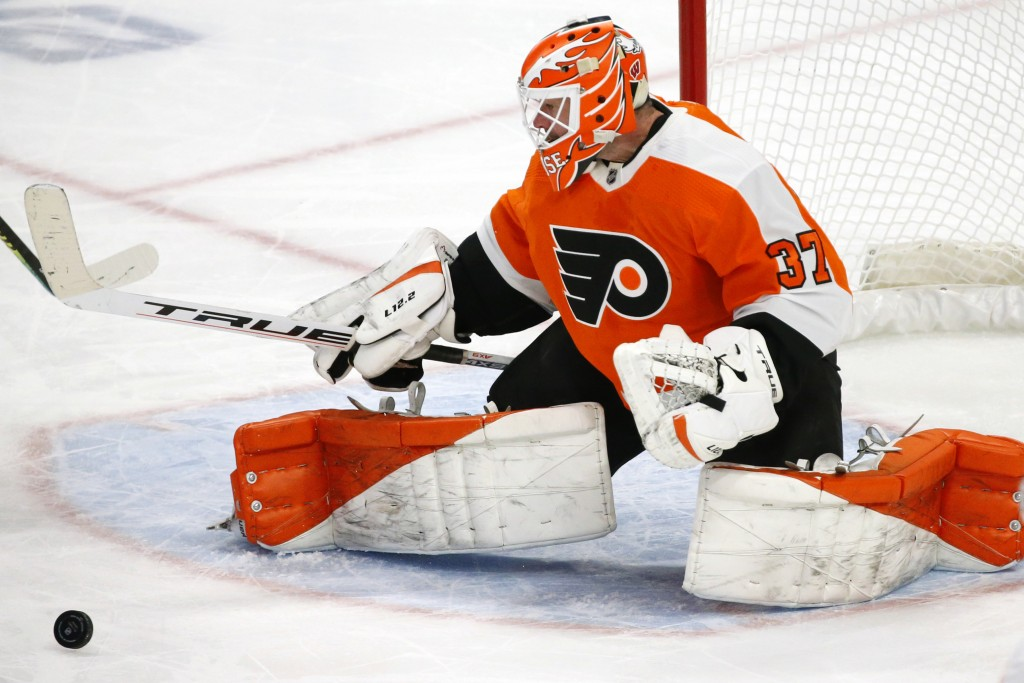 Philadelphia Flyers goalie Brian Elliott (37) makes a pad save during the third period of an NHL hockey game against the Buffalo Sabres, Saturday, Feb...