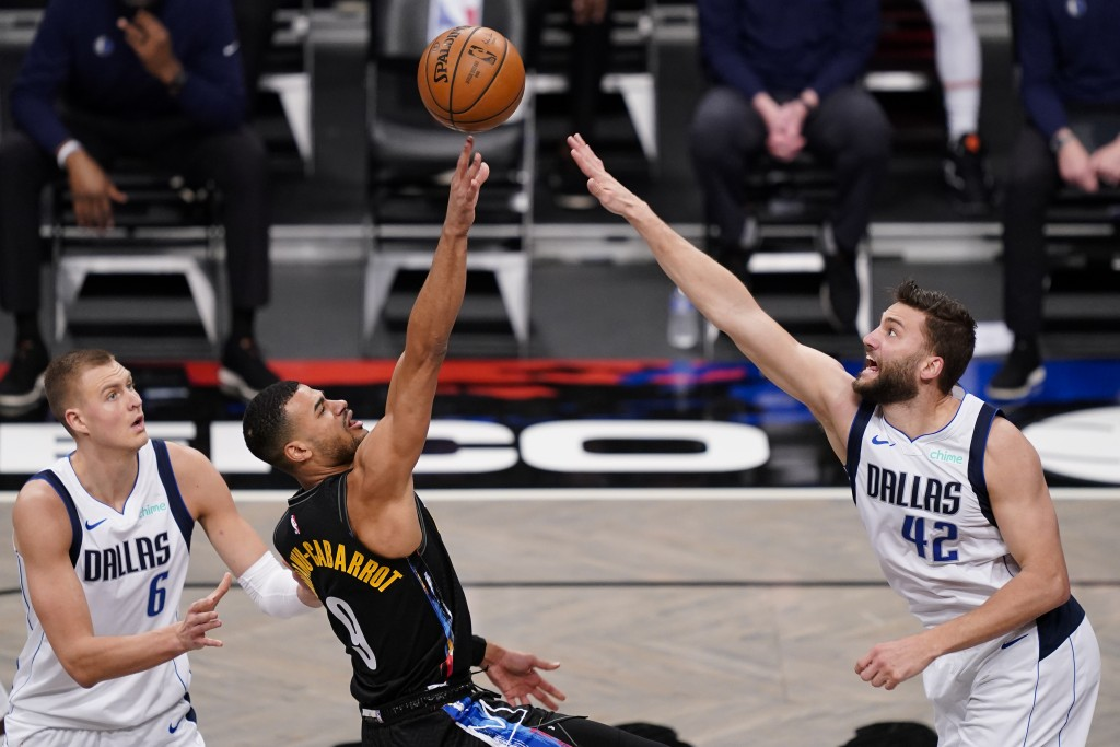 Brooklyn Nets guard Timothe Luwawu-Cabarrot (9) shoots against Dallas Mavericks forward Maxi Kleber (42) during the second half of an NBA basketball g...