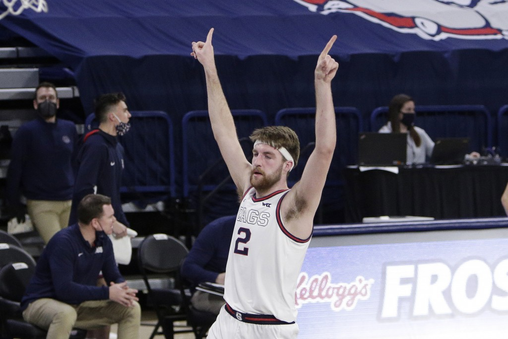 Gonzaga forward Drew Timme celebrates his basket during the second half of an NCAA college basketball game against Loyola Marymount in Spokane, Wash.,...