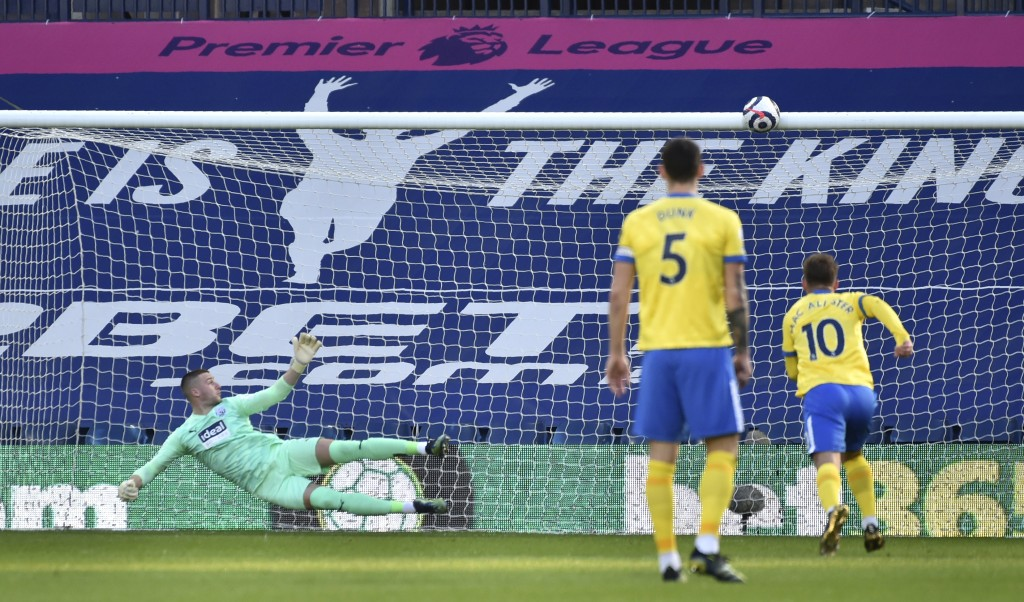 West Bromwich Albion's goalkeeper Sam Johnstone, left, fails to save the goal from Brighton's Lewis Dunk, centre, during the English Premier League so...