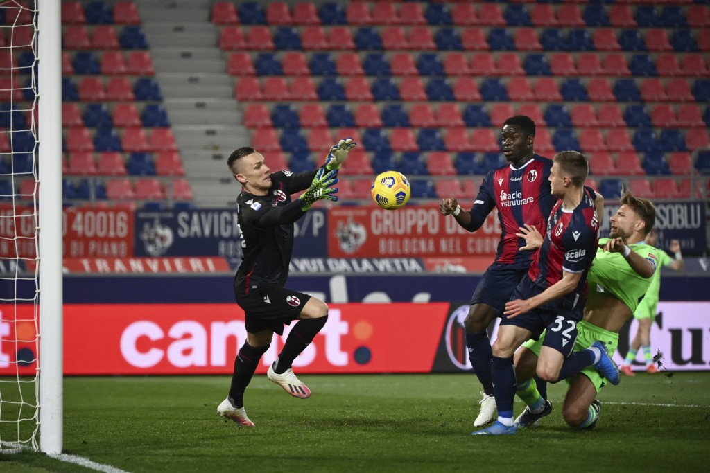 Ciro Immobile of S.S. Lazio competes for the ball with Lukasz Skorupski and Mattias Svanberg of Bologna F.C. during the Italian Serie A soccer match b...