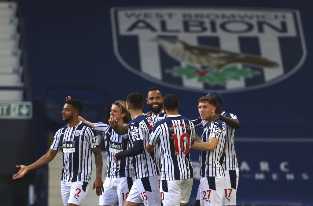 West Bromwich Albion's Kyle Bartley, centre, celebrates after scoring his side's opening goal during the English Premier League soccer match between W...