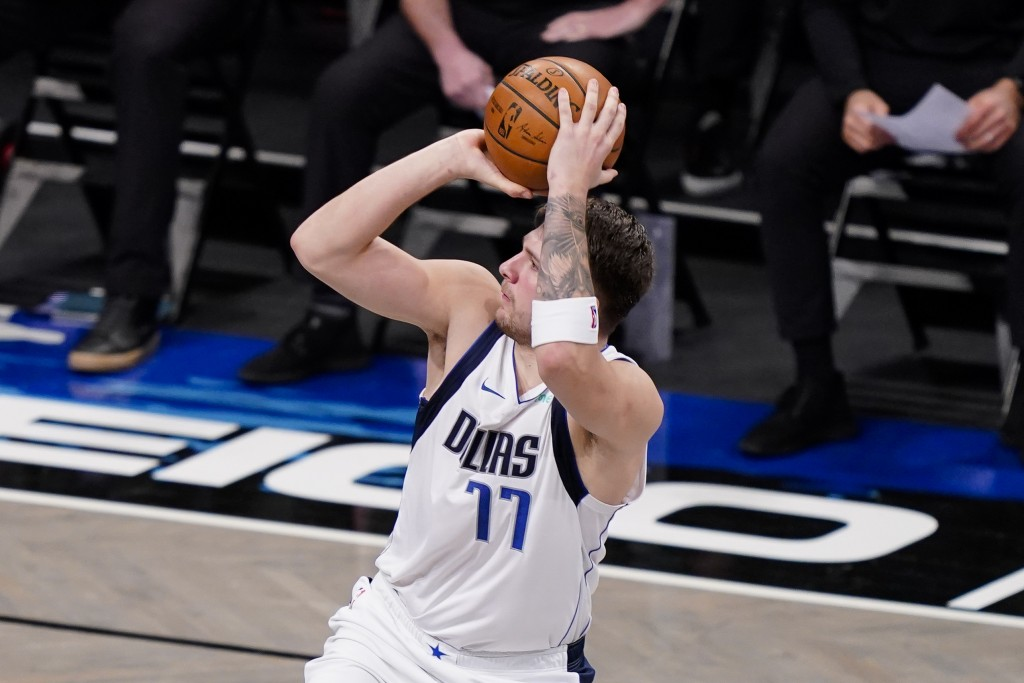 Dallas Mavericks guard Luka Doncic shoots during the second half of the team's NBA basketball game against the Brooklyn Nets, Saturday, Feb. 27, 2021,...