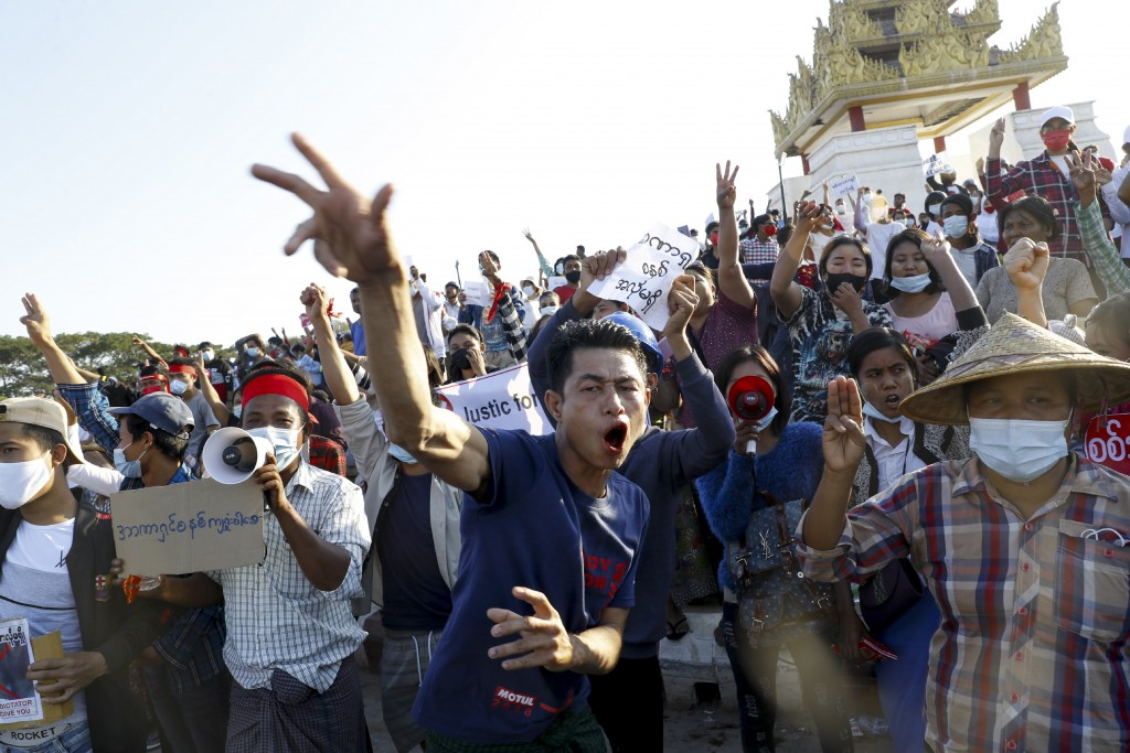 Demonstrators flash the three-fingered symbol of resistance against the military coup and shout slogans calling for the release of detained Myanmar le...