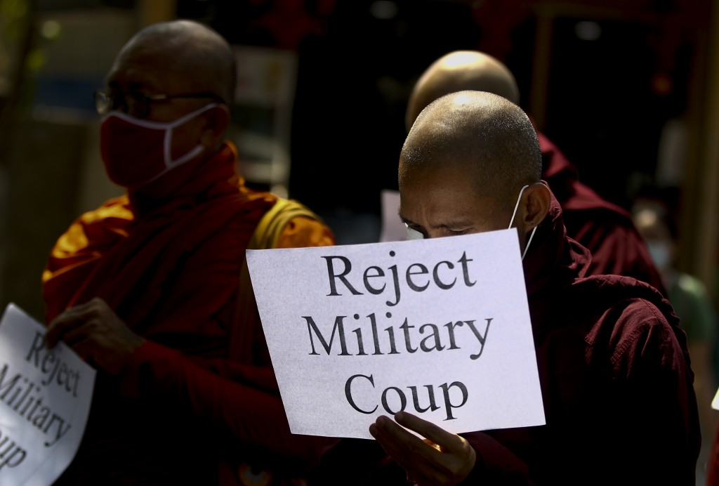 Buddhist monks display placrds during a protest march against the military coup in Yangon, Myanmar Tuesday, Feb. 16, 2021. In the month since Feb. 1 c...