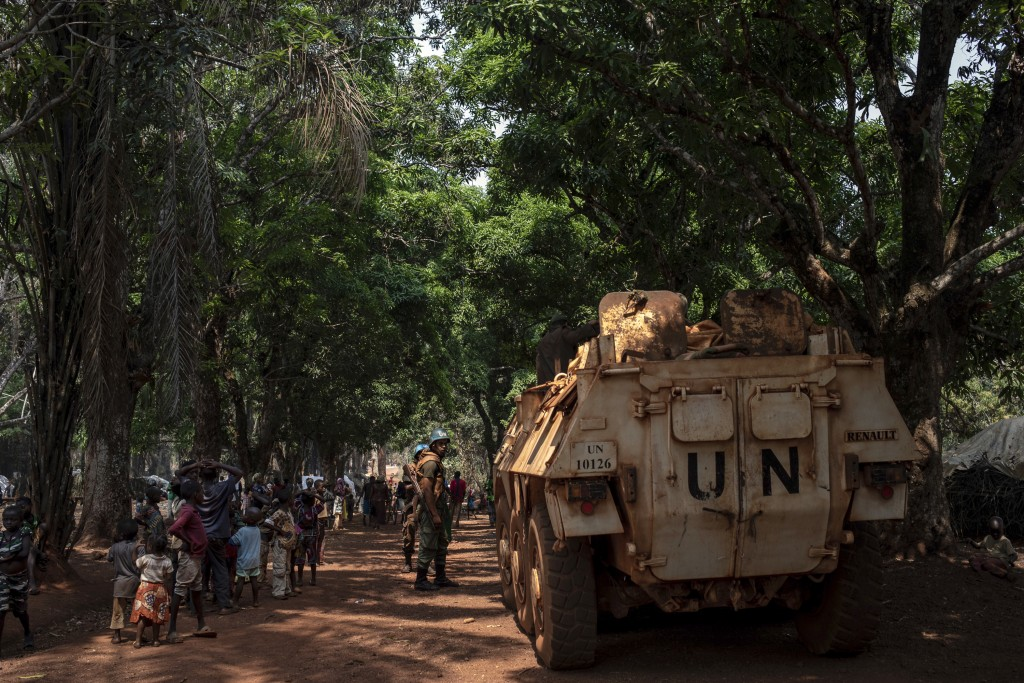 Moroccan UN peacekeepers patrol the village of Cesacoba, Central African Republic, Sunday Feb. 14, 2021. An estimated 240,000 people have been displac...