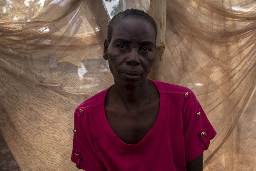 Bella Kembi, 49-years-old, is photographed Sunday Feb. 14, 2021 in her makeshift shelter in the village of Cesacoba, Central Africa Rebublic where she...