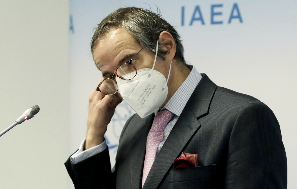 Director General of International Atomic Energy Agency, IAEA, Rafael Mariano Grossi from Argentina, removes his face mask before a news conference beh...