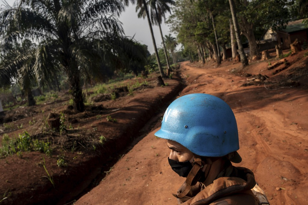 Moroccan UN peacekeepers patrol Bangassou, Central African Republic, Sunday Feb. 14, 2021. An estimated 240,000 people have been displaced in the coun...
