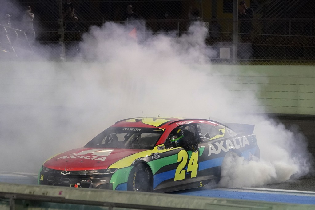 William Byron does doughnuts as he celebrates after winning a NASCAR Cup Series auto race, Sunday, Feb. 28, 2021, in Homestead, Fla. (AP Photo/Wilfred...