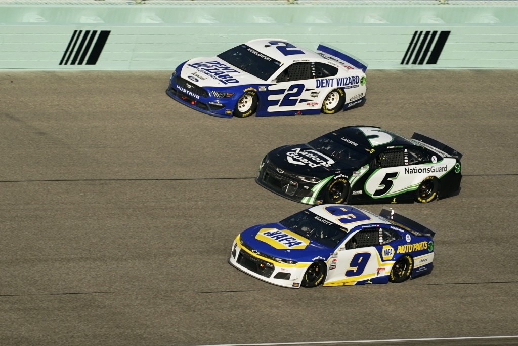 Brad Keselowski (2) Kyle Larson (5) and Chase Elliott (9) battle for position as they round turn four during a NASCAR Cup Series auto race, Sunday, Fe...