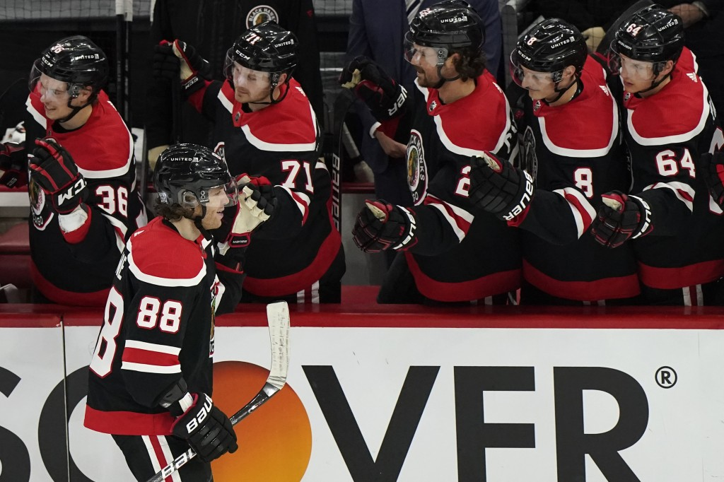 Chicago Blackhawks' Patrick Kane (88) celebrates with teammates after scoring a goal against the Detroit Red Wings during the third period of an NHL h...