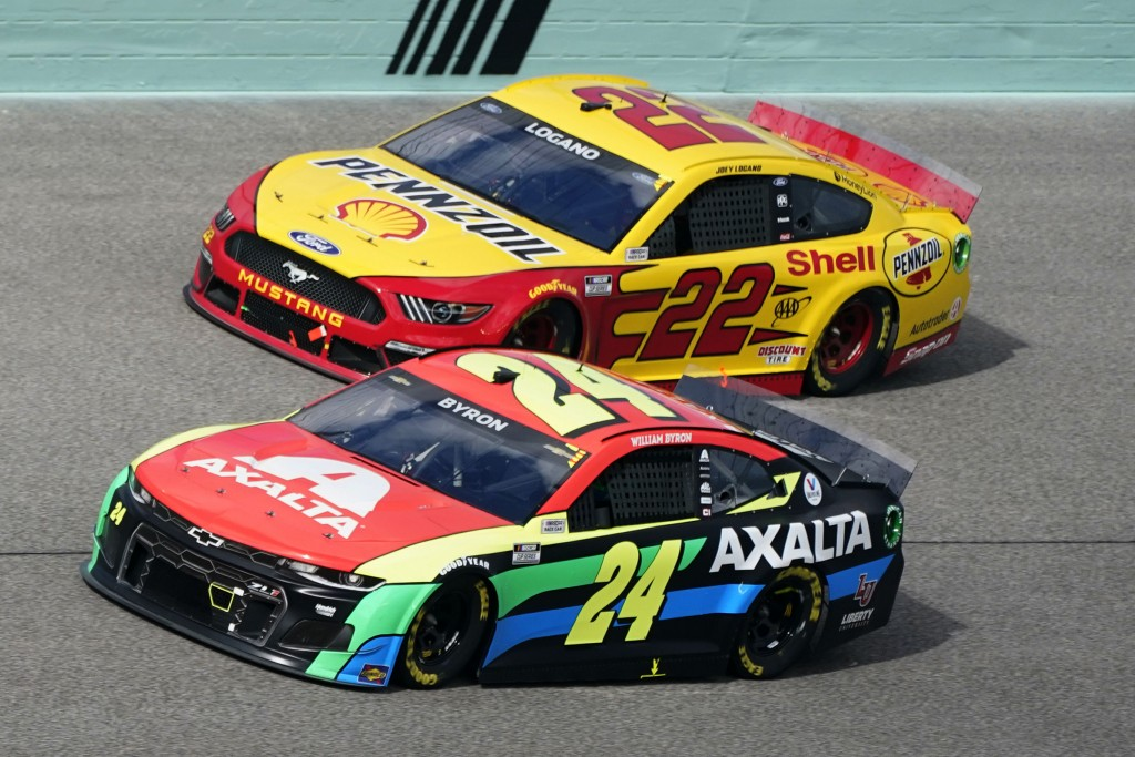 Joey Logano (22) and William Byron (24) battle for position during a NASCAR Cup Series auto race, Sunday, Feb. 28, 2021, in Homestead, Fla. (AP Photo/...