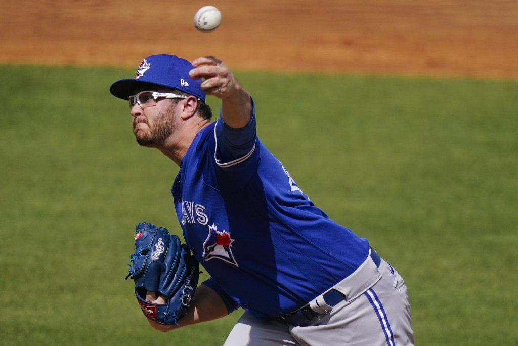 Toronto Blue Jays' Anthony Kay delivers a pitch during the first inning of a spring baseball game against the New York Yankees Sunday, Feb. 28, 2021, ...