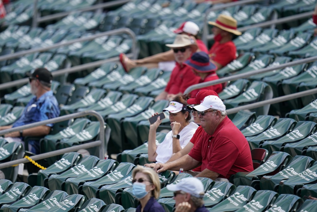 Fans sit in a socially distant pods inside Roger Dean Stadium during a spring training baseball game between the St. Louis Cardinals and Washington Na...