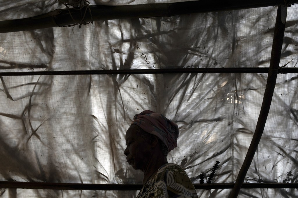 An 80-years-old woman who requested to remain anonymous sits in her makeshifts shelter in the village of Cesacoba, Central African Republic, Sunday Fe...