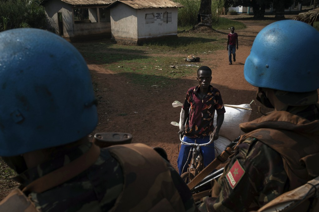 Moroccan UN peacekeepers patrol the town of Bangassou, Central African Republic, Monday Feb. 15, 2021. An estimated 240,000 people have been displaced...