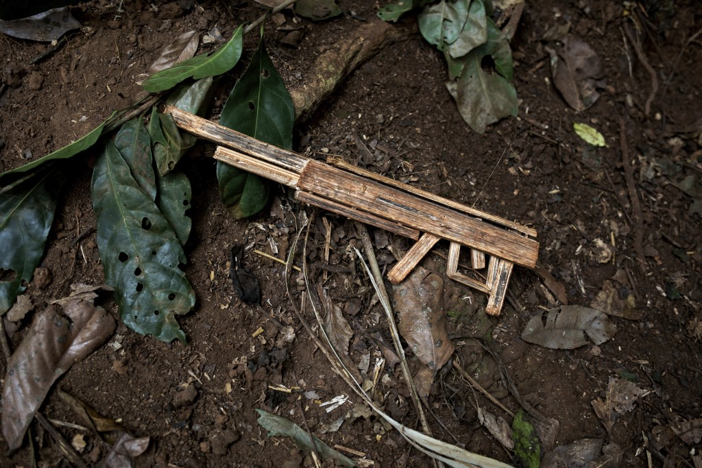 A toy machine gun sits in the mud in the village of Siwa, Central African Republic, Saturday Feb. 13, 2021. An estimated 240,000 people have been disp...