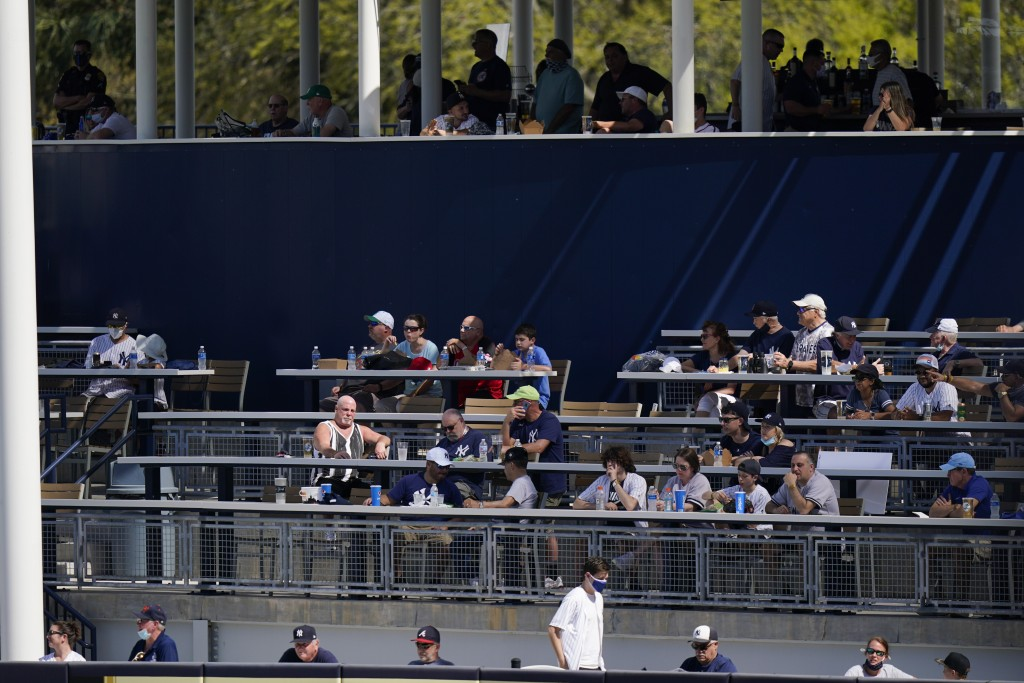 Fans watch during the fourth inning of a spring baseball game between the New York Yankees and the Toronto Blue Jays Sunday, Feb. 28, 2021, in Tampa, ...