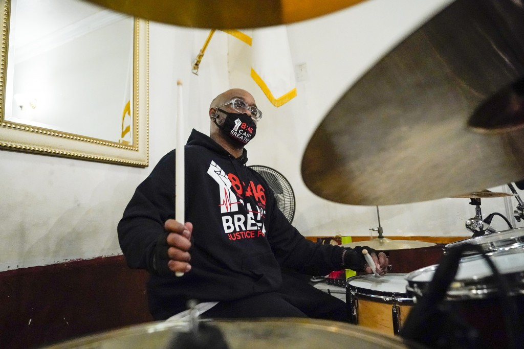 Terrence Floyd, brother of George Floyd, plays the drums with other artists during a recording session for an album of protest songs with the Rev. Kev...