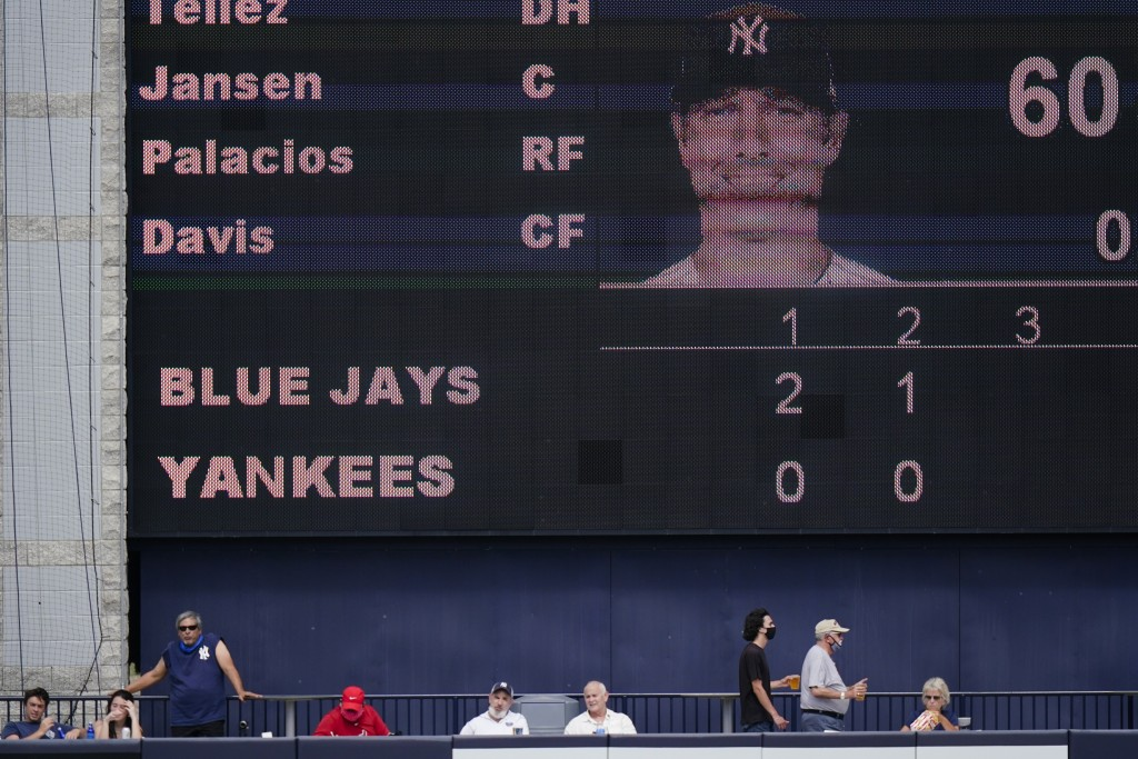 Fans watch the Toronto Blue Jays play the New York Yankees before the third inning of a spring baseball game Sunday, Feb. 28, 2021, in Tampa, Fla. (AP...