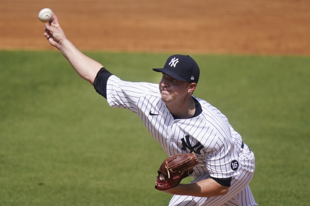 New York Yankees' Michael King delivers a pitch during the first inning of a spring baseball game against the Toronto Blue Jays Sunday, Feb. 28, 2021,...