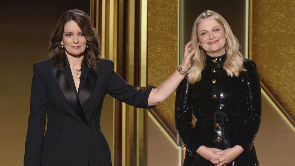In this video grab issued Sunday, Feb. 28, 2021, by NBC, hosts Tina Fey, left, from New York, and Amy Poehler, from Beverly Hills, Calif., speak at th...