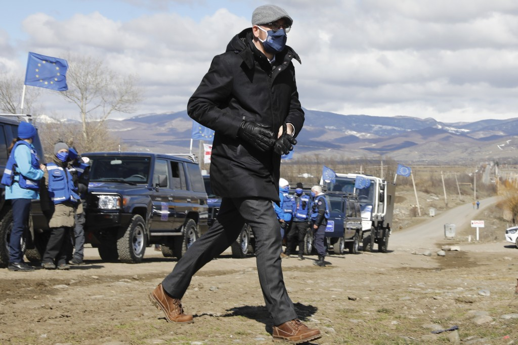 In this handout photo provided by the European Union Press Office, European Council President Charles Michel inspects Administrative Boundary Line wit...