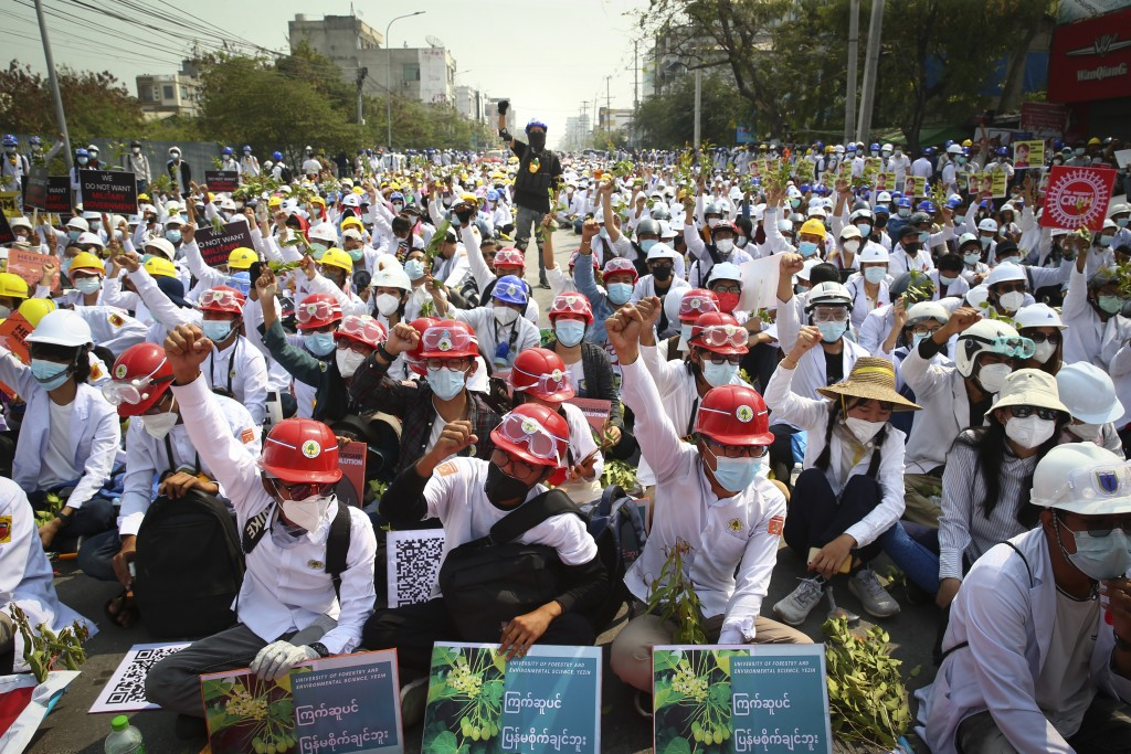 Protesters shout slogans during a protest against the military coup in Mandalay, Myanmar, Sunday, Feb. 28, 2021. In the month since the Feb. 1 coup, t...