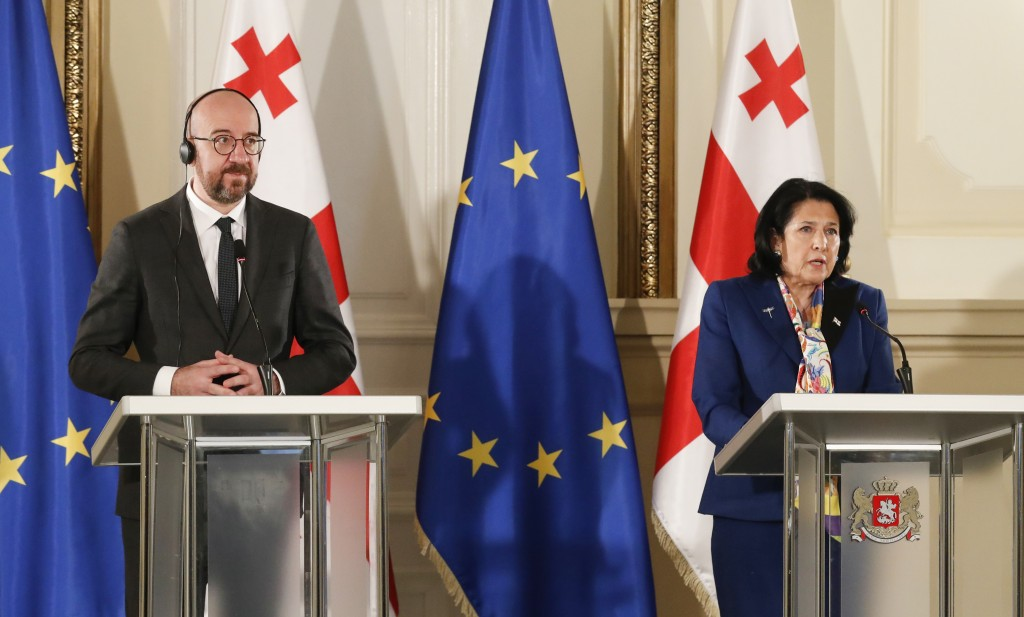 In this photo provided by the Georgian Presidential Press Office, Georgia's President Salome Zurabishvili, right, speaks during a joint news briefing ...