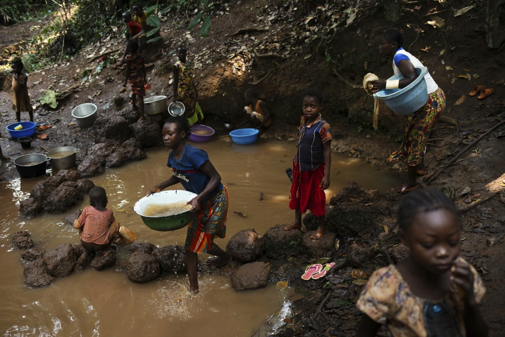 Displaced people who fled Bangassou use this water source to drink, cook and wash in the village of Siwa where they found refuge, in Central African R...