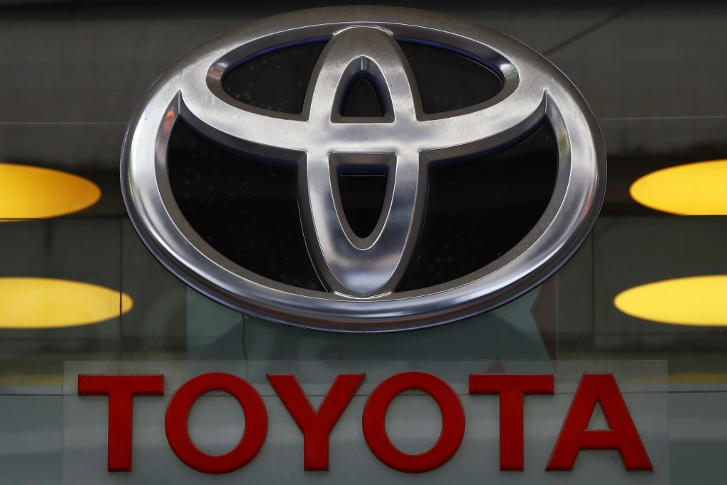 FILE - In this Sept. 20, 2017, file photo the Toyota logo is displayed at their shop on the Champs Elysees Avenue in Paris. The U.S. government is inv...