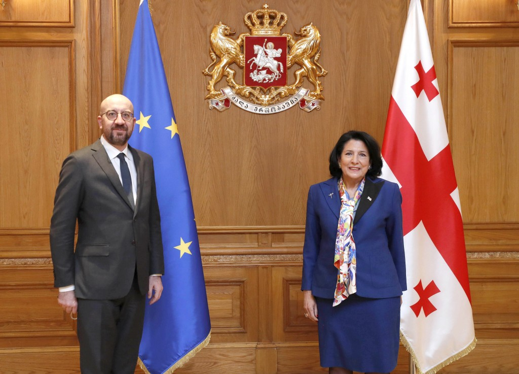In this photo provided by the Georgian Presidential Press Office, Georgia's President Salome Zurabishvili attends a meeting with European Council Pres...