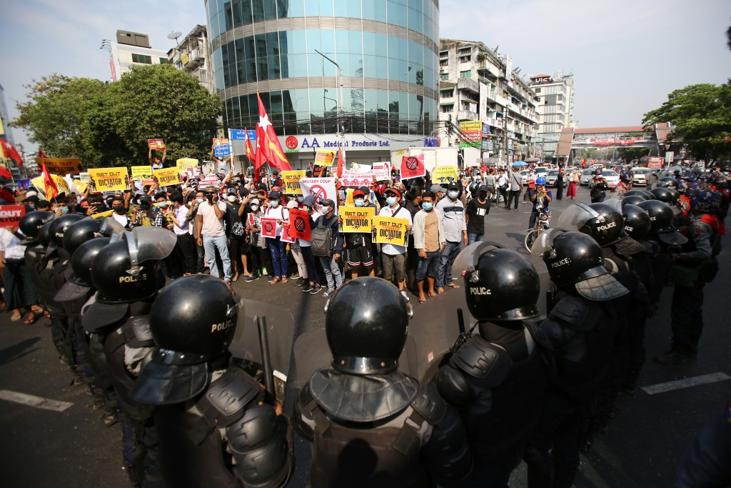 Anti-coup protesters face a row of riot police in Yangon, Myanmar Friday, Feb. 19, 2021. In the month since Feb. 1 coup, the mass protests occurring e...