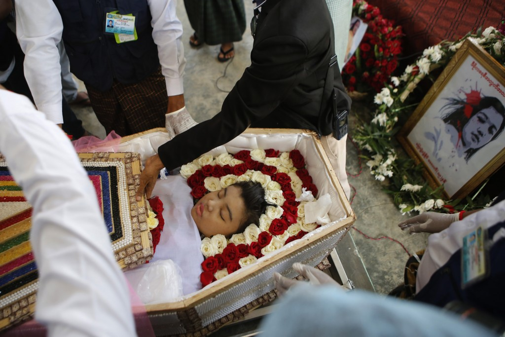 Mya Thwet Thwet Khine lies in a coffin during her funeral in Naypyitaw, Myanmar, Sunday, Feb. 21 2021. She was the first confirmed death among the man...